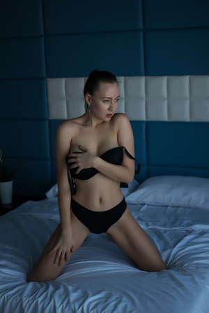 Topless voluptuous woman in bedroom