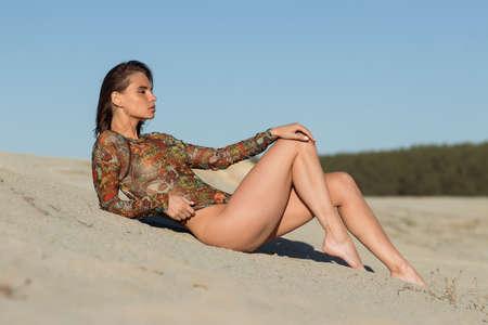 Slim woman resting on beach