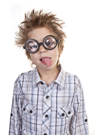 poking: Intelligent young boy poking his tongue out. Stock Photo