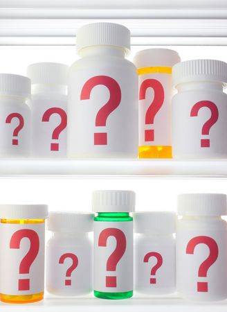 Close crop of medicine cabinet shelves filled with pill bottles, each labeled with a red question mark.  스톡 콘텐츠