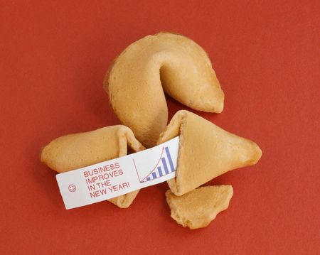 good fortune: Two fortune cookies on a red background. One is opened, showing a fortune saying,