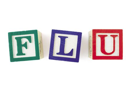 swine flu vaccine: Alphabet blocks forming the word FLU and viewed from above.