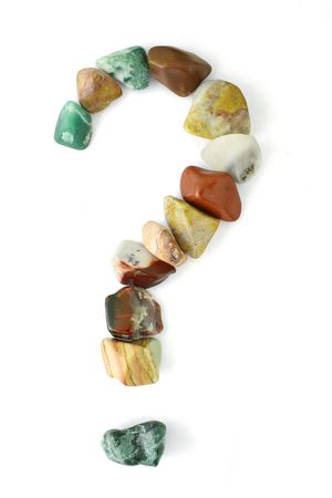 A question mark formed of polished stones of various colors. Stock Photo - 6393511