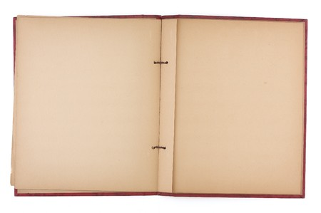 An old scrap book, open to reveal yellowing blank pages. Stock Photo - 7580905