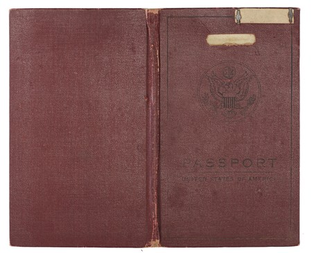 A brown U.S. Passport from the 1920s open to show back and front cover. Stock Photo