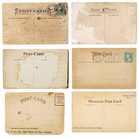 A set of six mildly heavily distressed vintage from early 1900s. Postcards are blank with room for your text and images. Isolated on white  Stock Photo