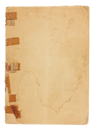 An old pamphlet viewed from above with very old, yellowed tape on the broken binding.  The cover page is water stained, torn and yellowing with rough edges and dog-eared corners and is blank with room for text and images. Isolated on white