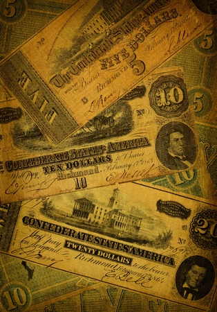Collage of old, dirty and very worn five, ten and dollar bills printed by the Confederate states of America in 1864 during the Civil War.