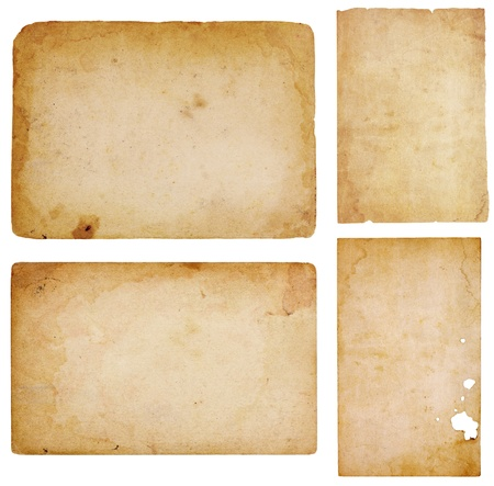 paper sheet: Set of four aged, worn and stained paper scraps isolated on white with room for text or images.
