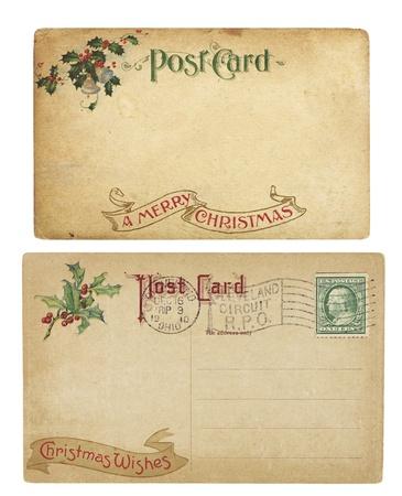Twee veroudering Christmas time ansichtkaarten uit 1910, geïsoleerd op wit.