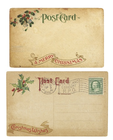 Two aging Christmas time postcards from 1910, isolated on white.