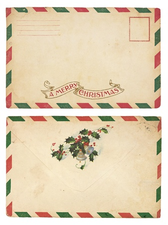 The front and back of an aging Christmas envelope with red and green striped border.  Stock Photo