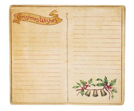 クリスマスのウィッシュ リスト メモ空白を明らかにする本を開いた高齢化のページが並ぶ。