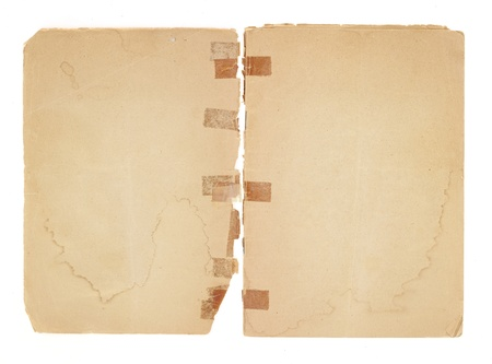 water stained: Two blank facing pages from an old pamphlet.  There is very old, yellowed tape on the binding which has been broken. The paper is water stained, torn and yellowing. The edges are rough and corners are dog-eared.