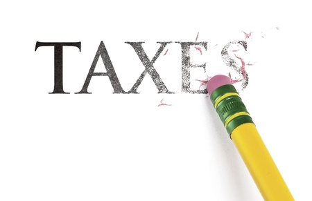 erase: Close up of a yellow pencil erasing the word, Taxes. Isolated on white.