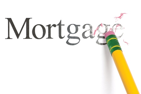 Close up of a yellow pencil erasing the word, Mortgage. Isolated on white.