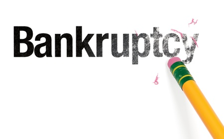 Close up of a yellow pencil erasing the word, Bankruptcy. Isolated on white.