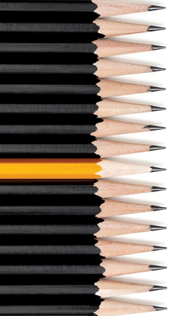 Row of black pencils with one yellow pencil in middle. On white with drop shadow.  Stock Photo