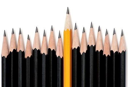 taller: Uneven row of black pencils with one yellow pencil in middle rising taller than the rest. On white with drop shadow