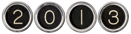 0 1 years: Old, scratched chrome typewriter keys with black centers and white letters spelling out 2013