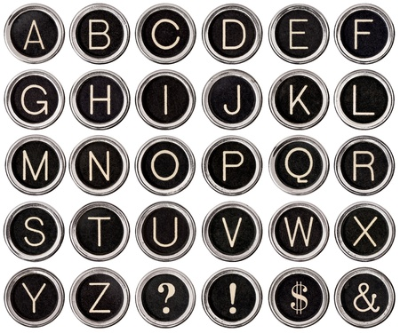 Full alphabet of vintage typewriter keys including dollar sign, ampersand, exclamation and question marks
