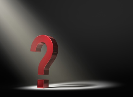 A red question mark in the dark lit by a single, yellow spotlight    Stock Photo - 17935150