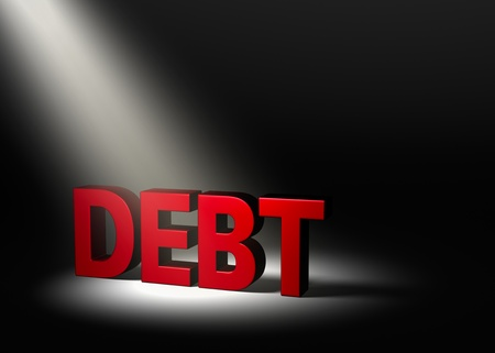 insolvency: Shiny red  DEBT  in the dark, illuminated by a single spotlight from above left  Stock Photo