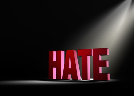 hostility: Angled spotlight backlighting and revealing red HATE on a dark background. Stock Photo