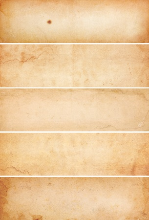 water stained: Collection of five heavily aged and water stained blank paper banners.  Isolated on white. Stock Photo