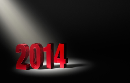 beginnings: Shiny Red 2014 on dark stage, brightly illuminated from upper left by angled spotlight  Stock Photo