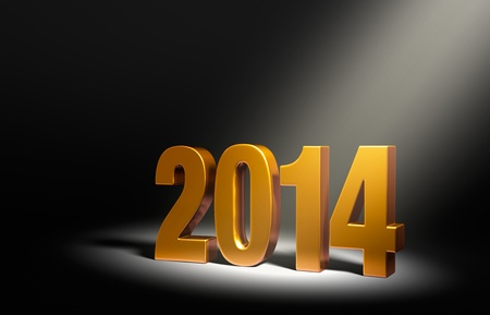 right angled: Gold 2014 on dark stage, brightly illuminated from upper right by angled spotlight. Stock Photo