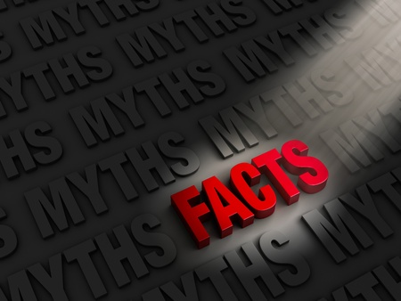 in fact: A spotlight illuminates bright, red  FACTS  on a dark background of  MYTHS  Stock Photo