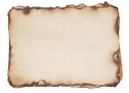 Bundle of several weathered, old papers with fire damaged and burned edges  Isolated on white  Stock Photo