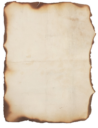 burned paper: Old, creased and smudged paper with fire damaged and burned edges  Blank with room for text or images  Isolated on white