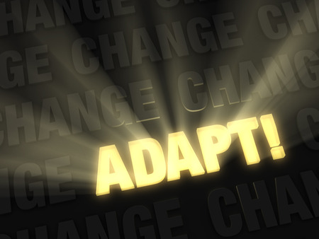adapting: Brilliant light rays burst from a glowing, gold  ADAPT   on a dark, gray background of  CHANGE  Stock Photo
