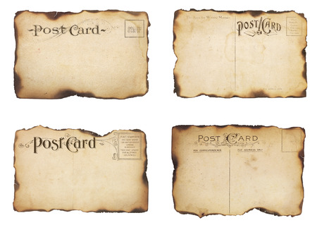 A set of four heavily aged, unstamped post cards from early 1900s   Postcards are mostly empty with room for additional text and images  Isolated on white