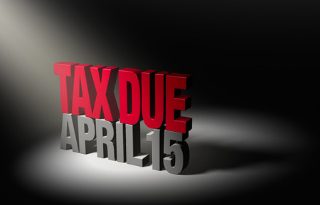 due date: A spotlight illuminates a shiny bold, red  TAX DUE  atop a dark gray  APRIL 15  on a dark
