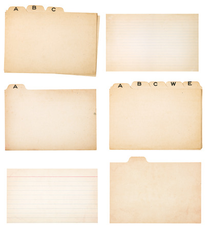 Collection of yellowing tabbed index cards and two faded, lined index cards without tabs   Each card or group is isolated on white with clipping path