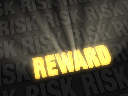 Brilliant light rays burst from a glowing, gold  REWARD  on a dark of  RISK  Stock Photo