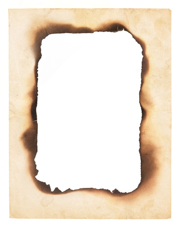 A frame or border formed from a very old, creased paper with the center burned away leaving a blank space  Isolated on white