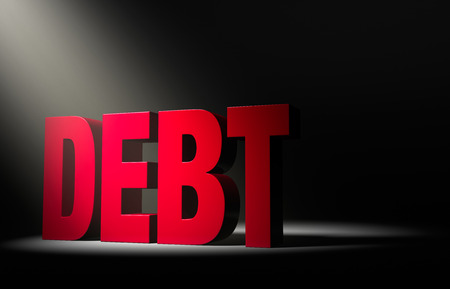 indebtedness: Angled spotlight revealing a large, looming red  DEBT  on a dark background