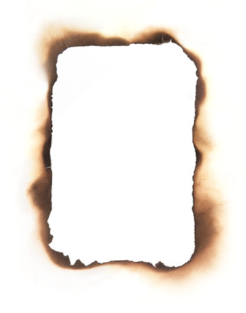 The charred  edges of a burned through rectangular hole isolated on white  Use as a frame or composite with any sheet of paper to create a burned through area in the paper  Reklamní fotografie