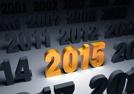 beginnings: A shining, gold  2015  stands out in a dark field of other years Stock Photo