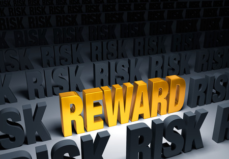 exciting: A shining, gold  REWARD  stands out in a dark field of gray  RISK s Stock Photo