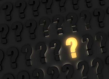 ponder: A bright, glowing yellow question mark stands out in a dark field of gray question marks Stock Photo