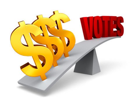 Three bright, gold dollar signs weigh one end of a gray balance beam down while a red VOTES sits high in the air on the other end. Focus is on dollar signs.  Isolated on white. Stock Photo