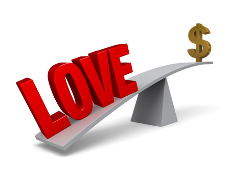 A bold, red LOVE weigh one end of a gray balance beam down while a gold dollar sign sits high in the air on the other end. photo