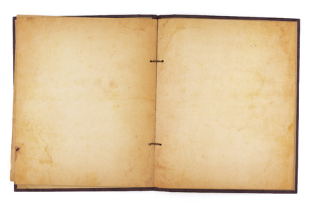 yellowing: An aging scrapbook open to reveal blank, yellowing water-stained pages. Isolated on white. Includes clipping path.