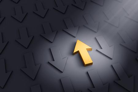 trailblazer: A spotlight illuminates a bright, gold up arrow on a dark gray background filled with down arrows. Stock Photo