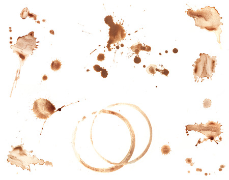 Collection of brown coffee stains and splatters isolated on white.